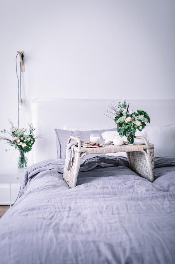 breakfast in bed in a minimalist home
